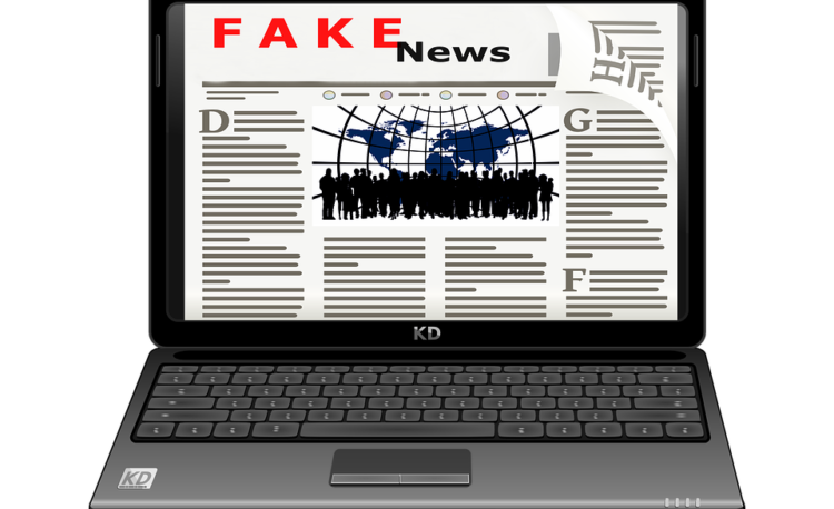 Image showing a laptop with a fake news page showing